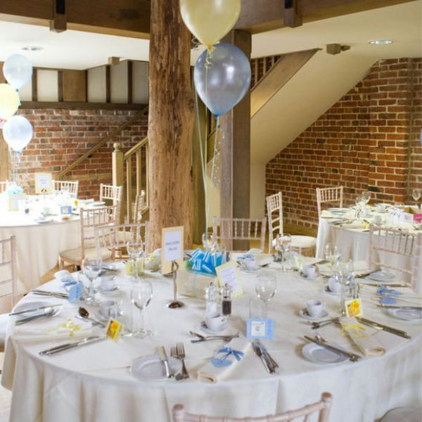 Cream yellow and blue table decorations for a reception – wedding barns Essex