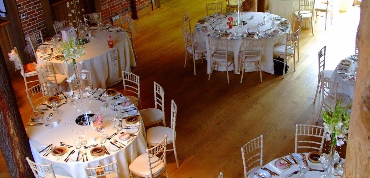 Gaynes Park's Mill Barn set up for a wedding reception – Essex wedding venues