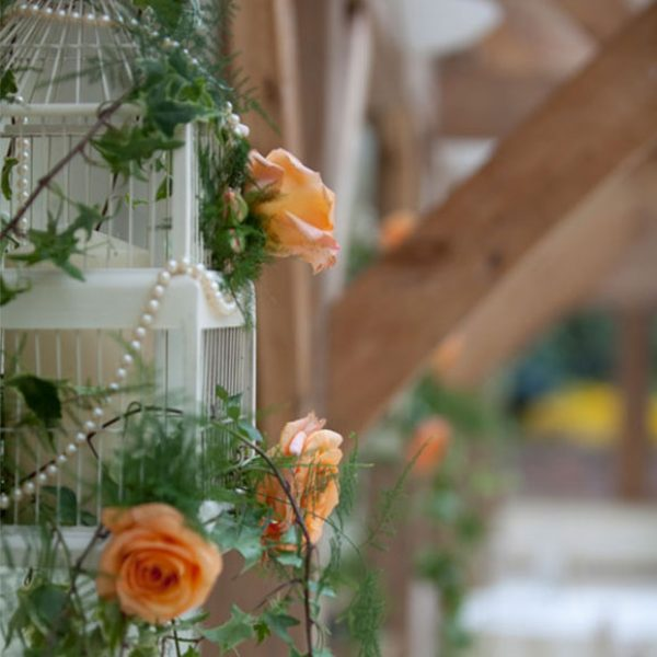 Bird cage filled with flowers as a wedding decoration