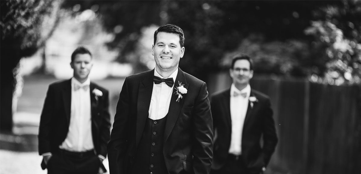 Groomsmen in the grounds of Gaynes Park wedding venue in Essex