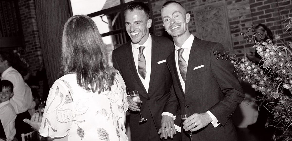 Black and white photo of grooms in their suits – barn weddings Essex