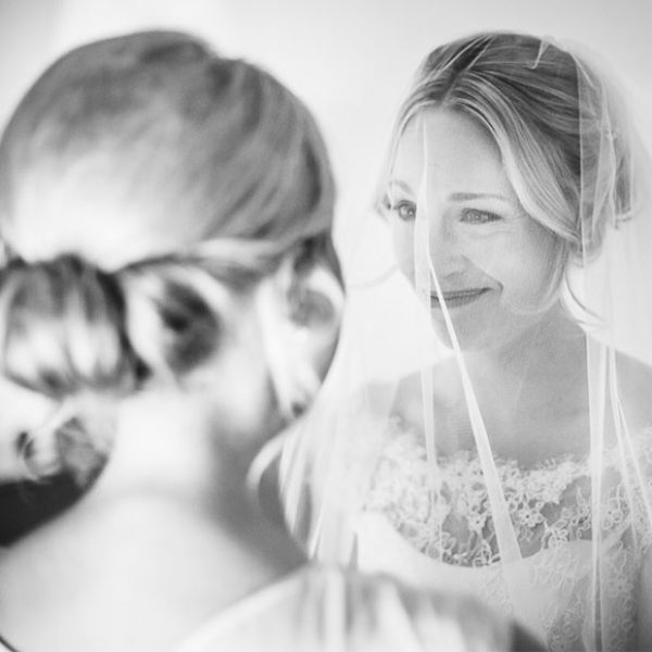 Bride and bridesmaid before the wedding ceremony at Gaynes Park in Essex
