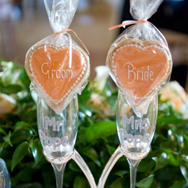 Bride and groom biscuits as wedding favours