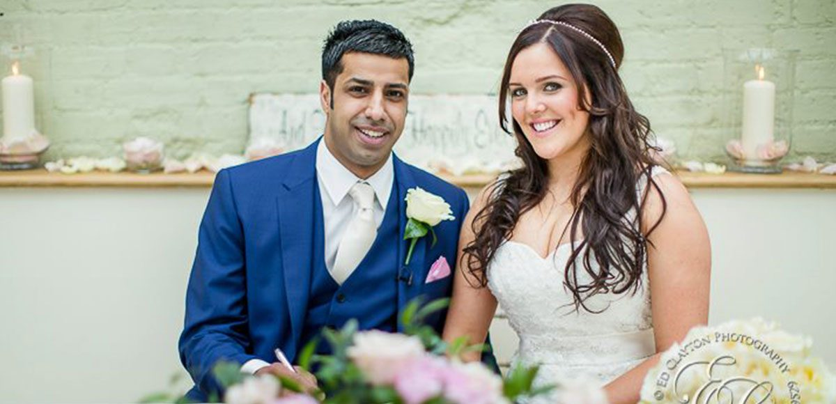 Bride and groom inside of the Orangery at Gaynes Park wedding venue