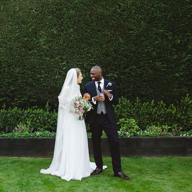 Bride and groom enjoying the gardens at Gaynes Park wedding venue in Essex