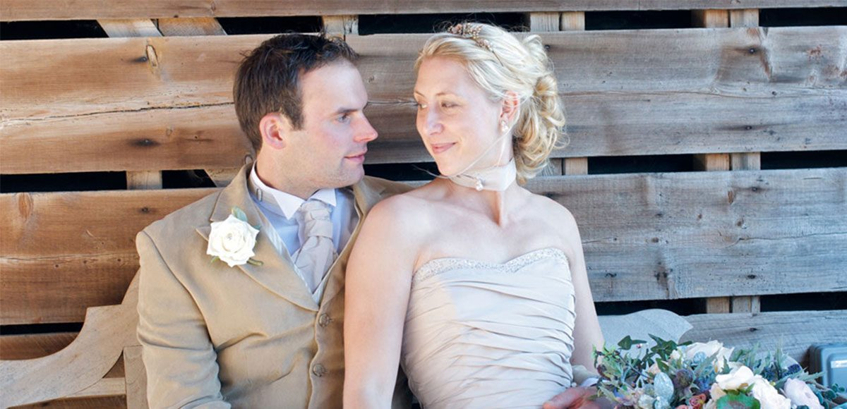 The happy couple enjoying their barn wedding at Gaynes Park in Essex