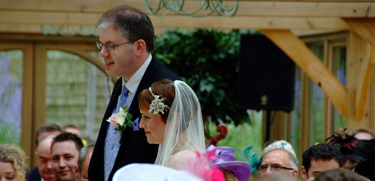 Bride and groom in the Orangery during wedding ceremony – wedding venues in Essex