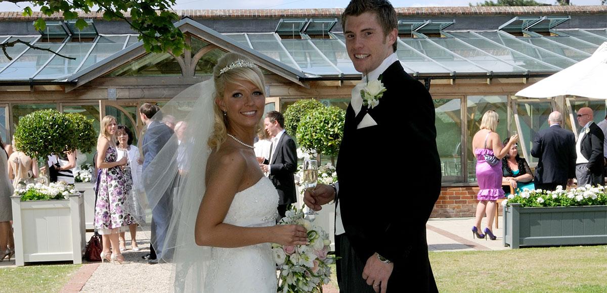 Bride and groom by the Orangery – wedding venues in Essex