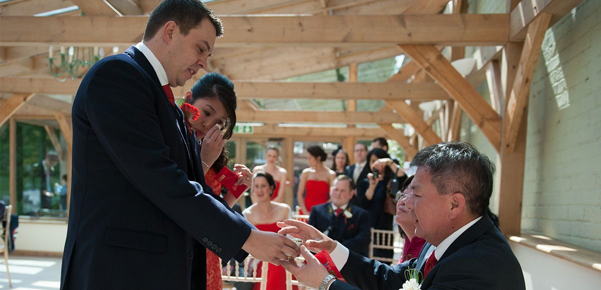 Parents with bride and groom for a tea ceremony – wedding barns Essex