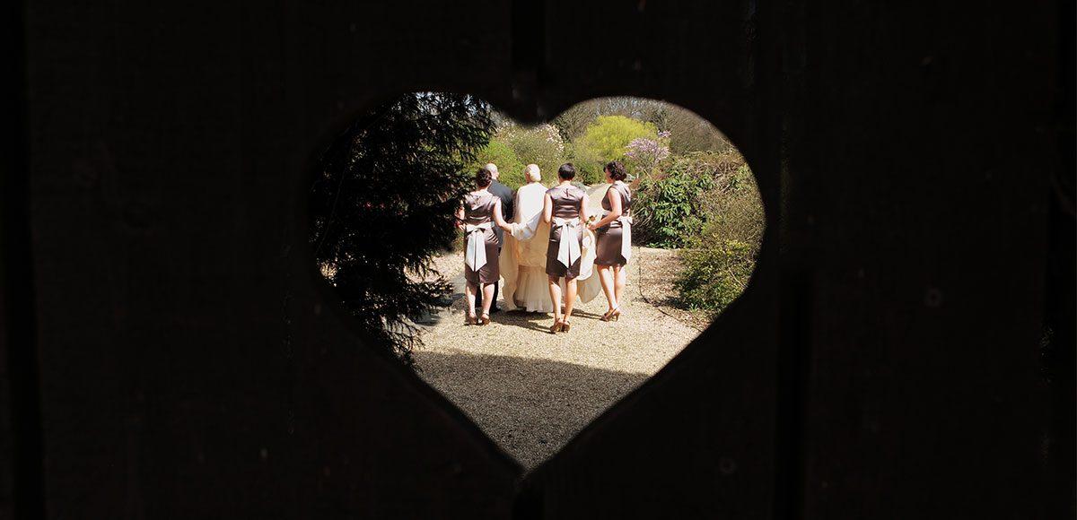 Bridesmaids in the gardens of Gaynes Park wedding venue