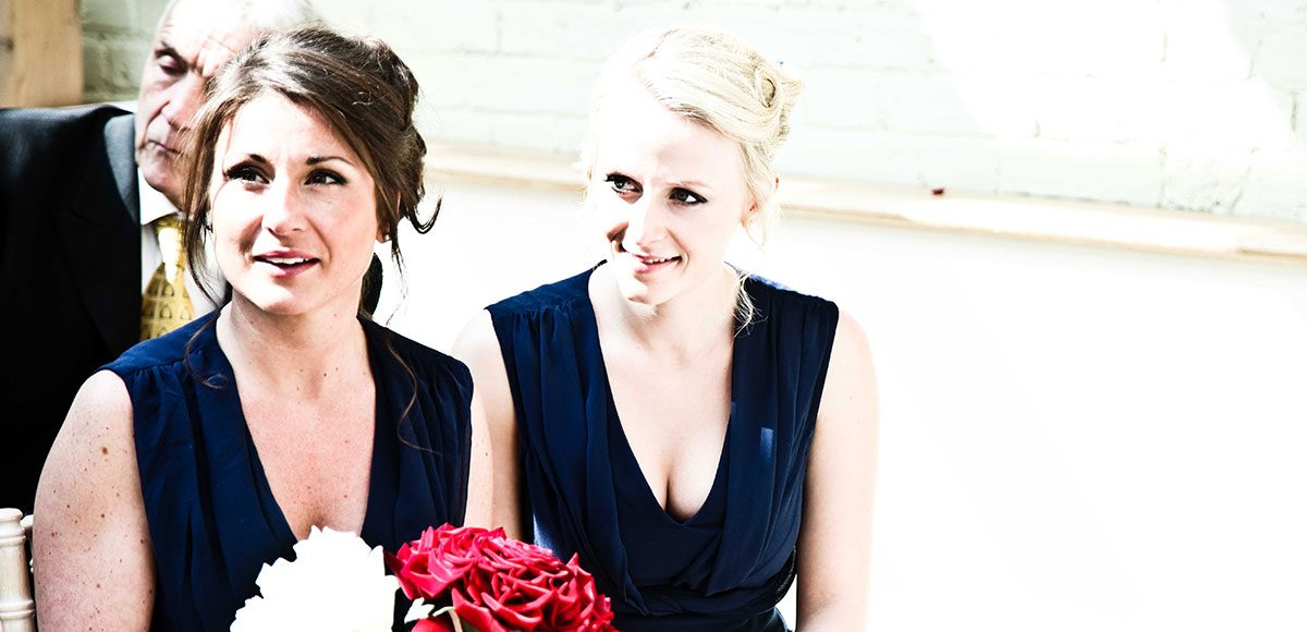 Bridesmaids watching the ceremony in the Orangery – wedding venues in Essex