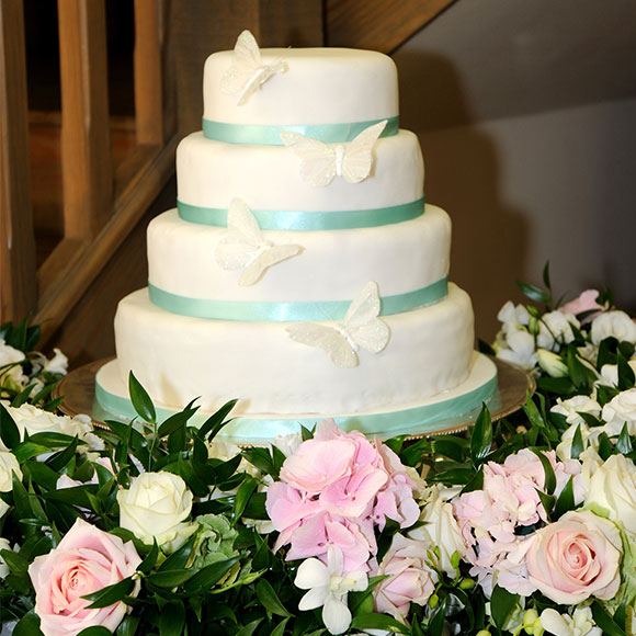 Butterfly wedding cake with flowers as decorations