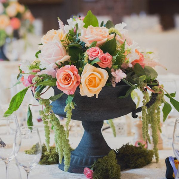 Colourful flower centrepieces for a barn wedding in Essex