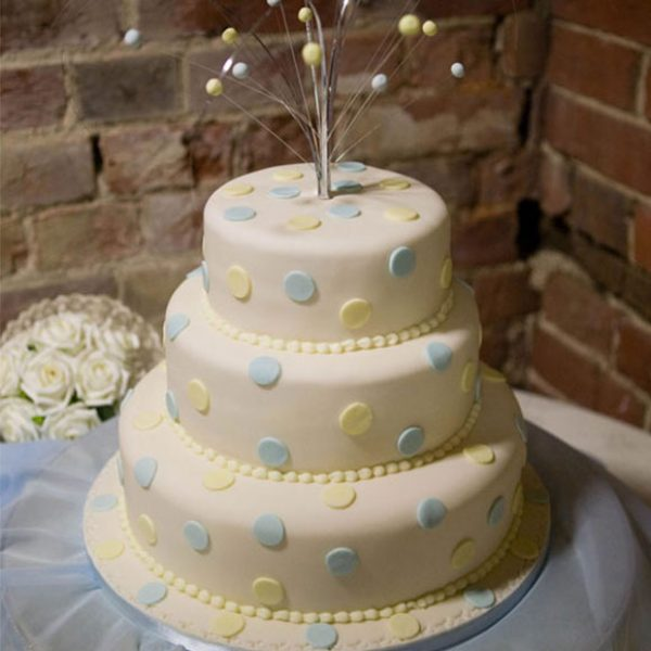 Cream and blue spotty cake for a Gaynes Park wedding reception – barn hire Essex