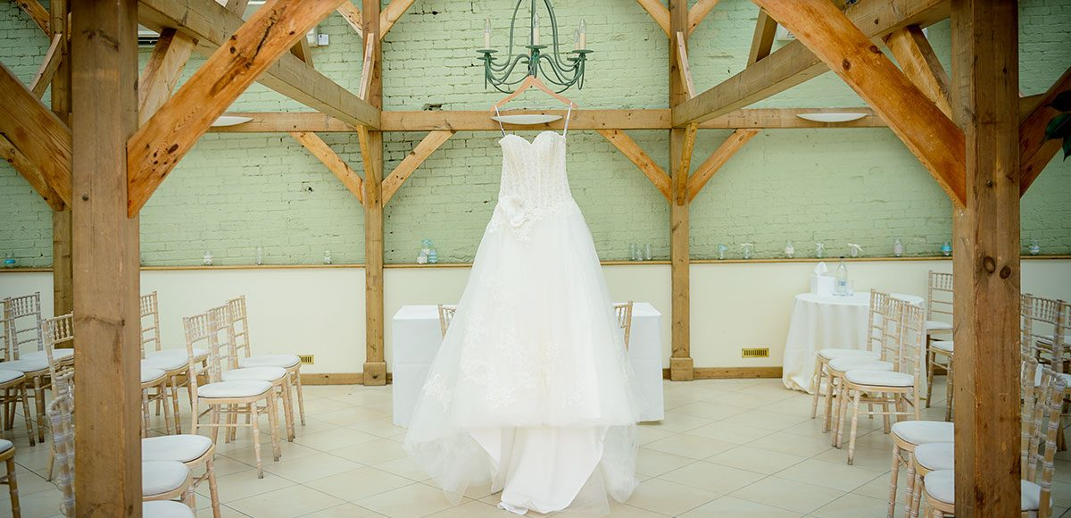 Wedding dress hanging up in the Orangery – wedding venues in Essex