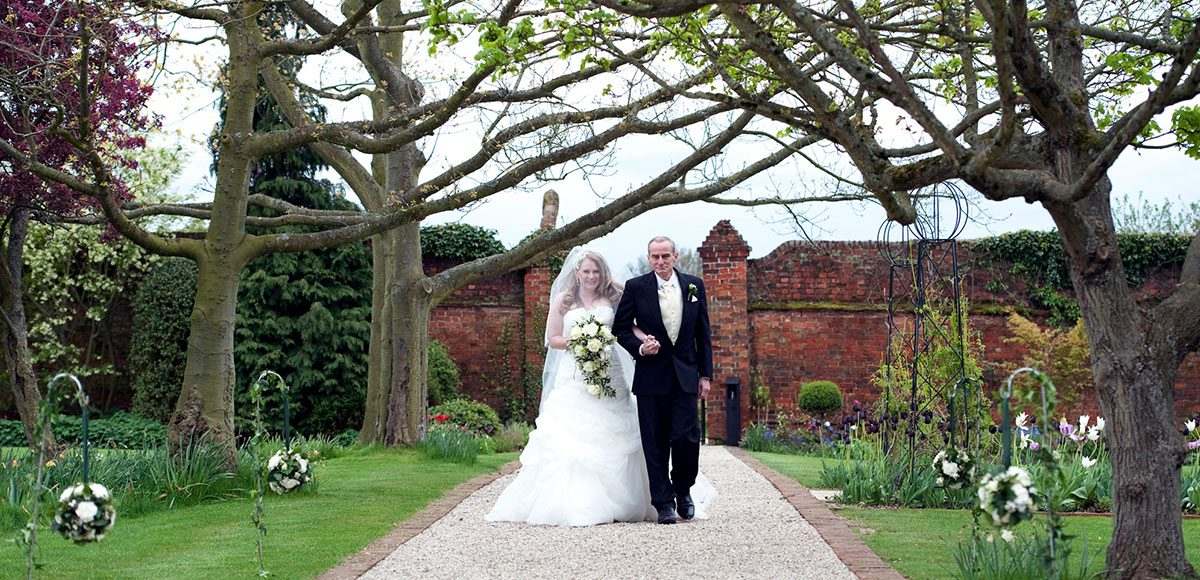 Bride walking down the Long Walk with her father – venues in essex