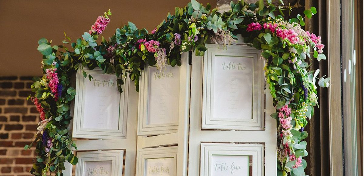 Spring flowers used to decorate a wedding table plan – venue hire Essex