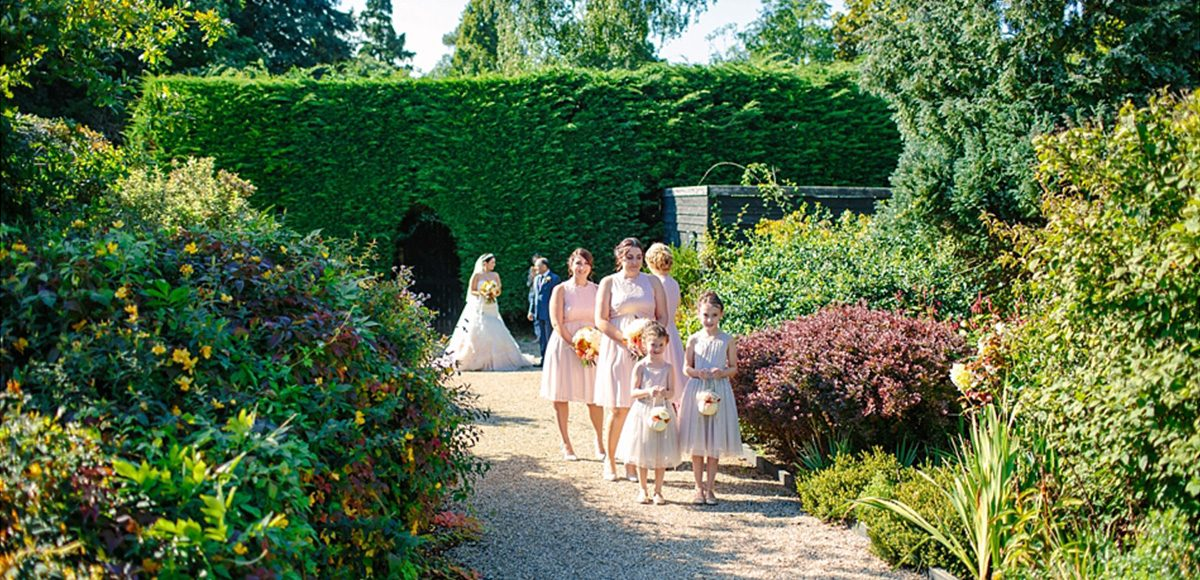 The bridal party get ready for the long walk down the garden aisle at Gaynes Park