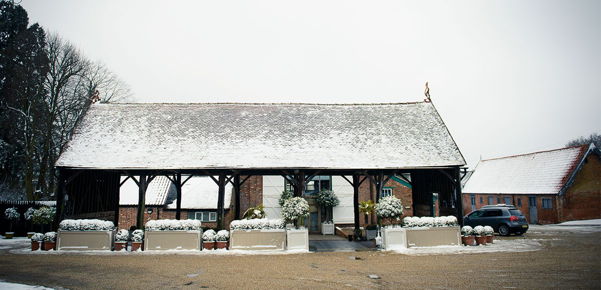 Gather Barn at Gaynes Park covered in snow – barn hire Essex