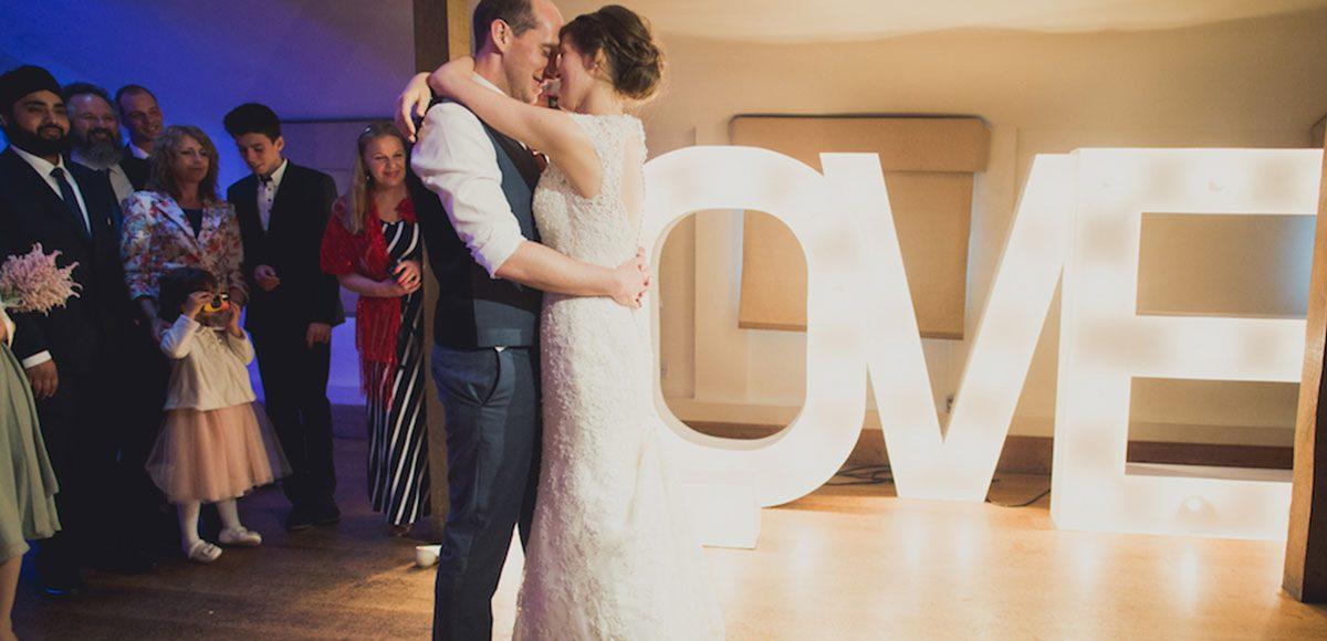 Bride and groom's first dance inside of Gaynes Park's barn
