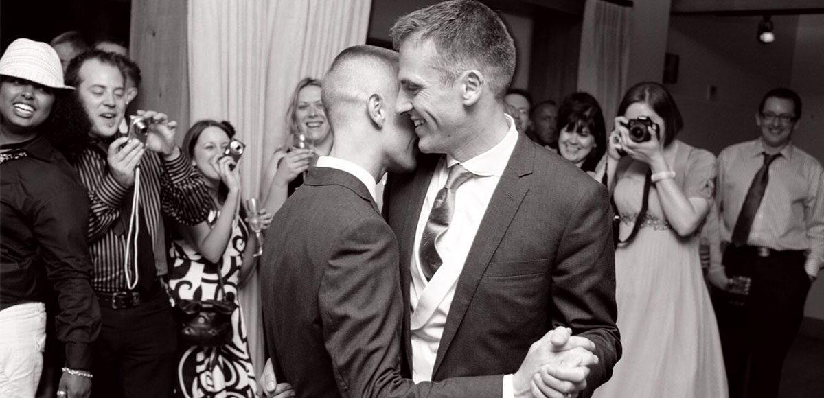 Grooms enjoying their first dance at Gaynes Park wedding venue
