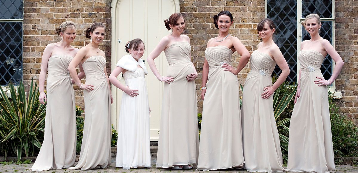Bridesmaids outside of the Coach House