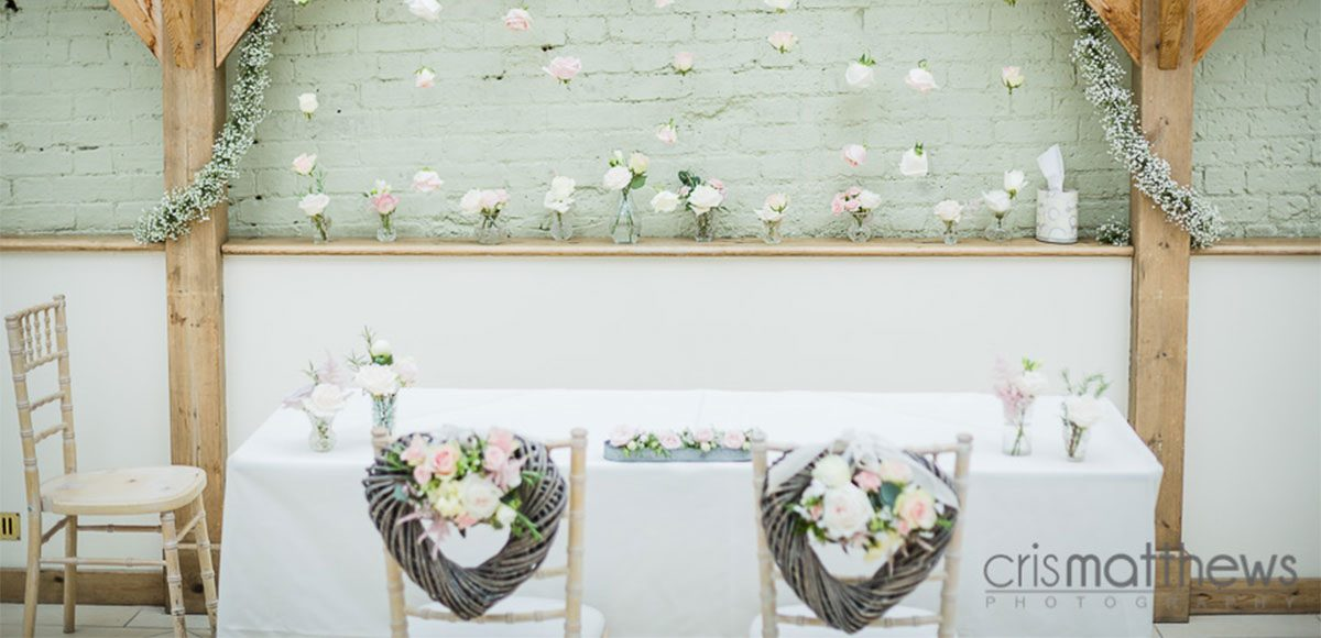 Flowers and heart decorations inside of the Orangery - Essex wedding venues