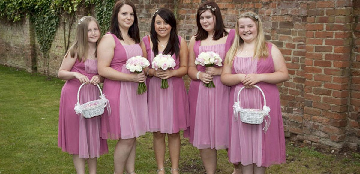 Bridesmaids in pink wedding dresses ready for a reception