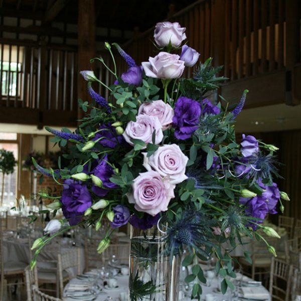 Purple and lilac flowers as wedding centrepieces – barn hire Essex