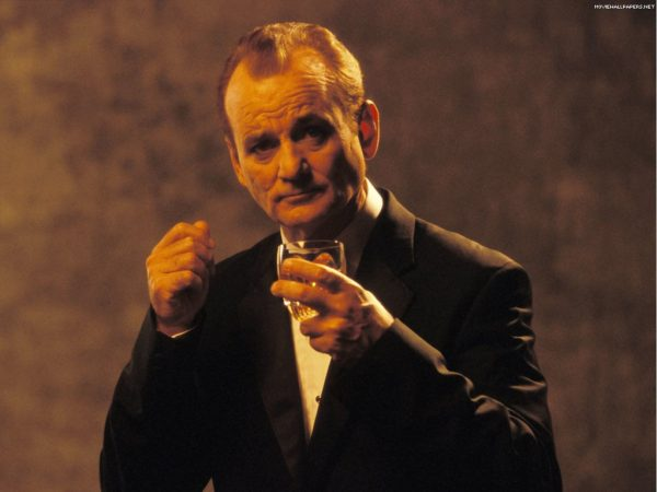 Possibly the most dapper man in the world, Bill Murray, wearing a tailored Italian tuxedo, clicks his fingers in time to light jazz while drinking an expensive single malt.