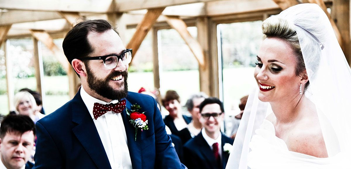 Bride and groom during their 1950s style wedding ceremony – barn wedding venue in Essex