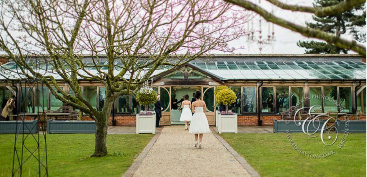 Spring wedding ceremony at Gaynes Park's Orangery