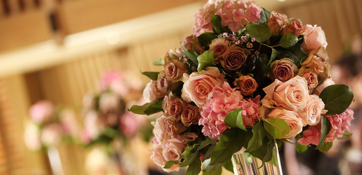 Tall vases for flower decorations at Gaynes Park – barn wedding venues in Essex