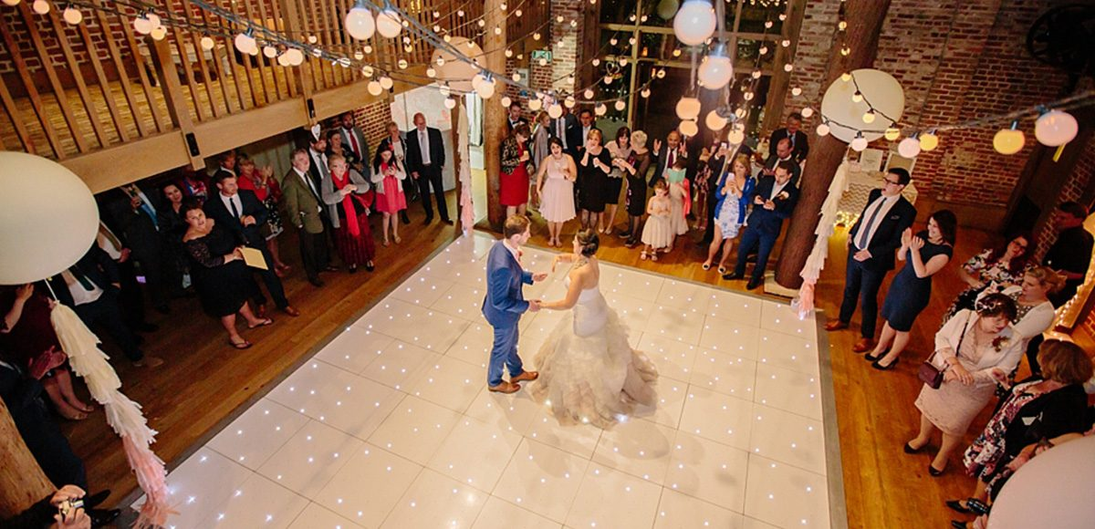 The couple take to the black and white dancefloor for their first dance