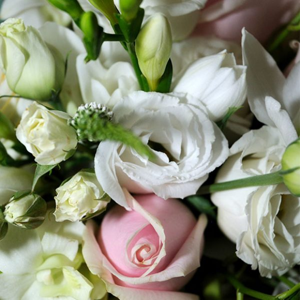 White and pink wedding bouquet for the bride