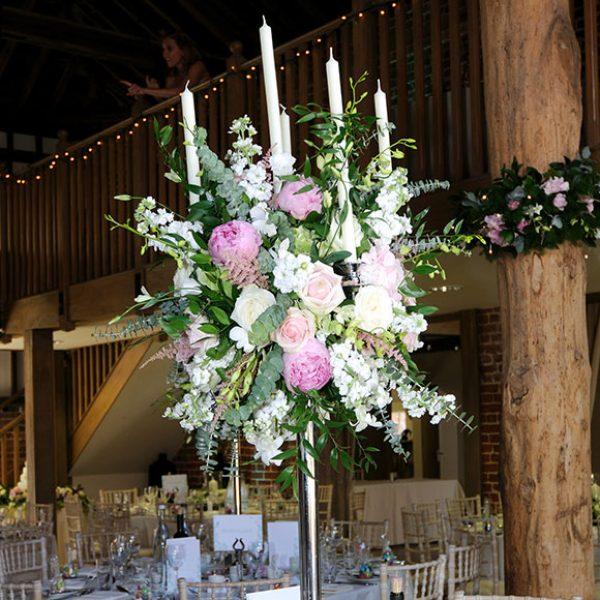 Flowers as a centrepiece for a barn wedding reception – wedding barns Essex