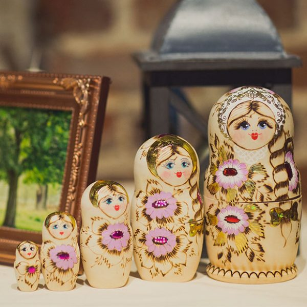 Russian dolls as wedding decorations for a barn wedding venue