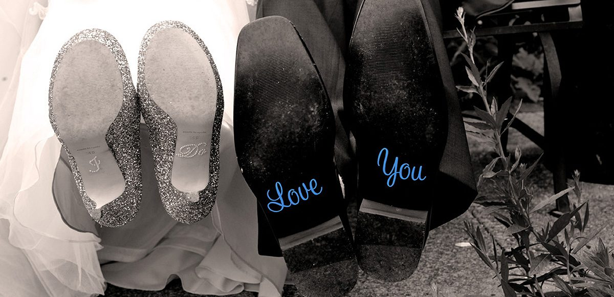 Cute decal details on the bottom of the bride's and groom's wedding shoes