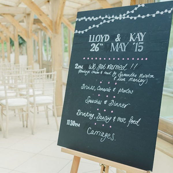 Chalkboard sign in the Orangery of Gaynes Park - wedding venues in Essex