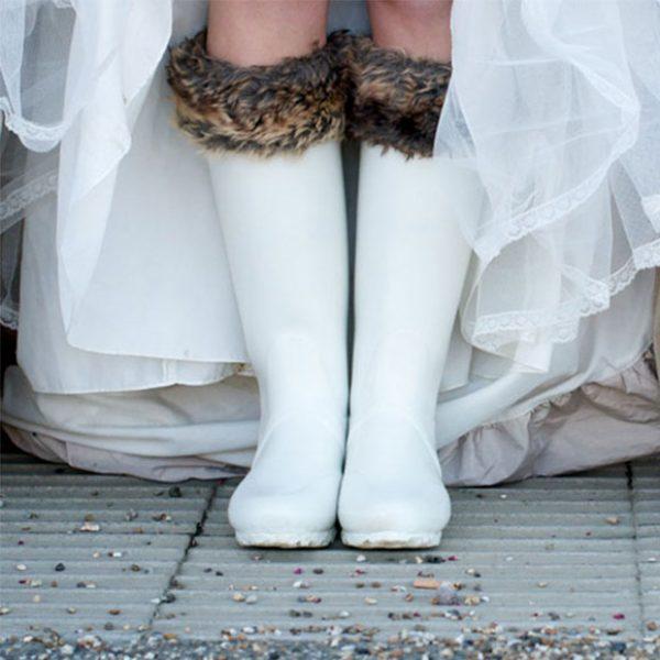 The bride wore white wedding wellies