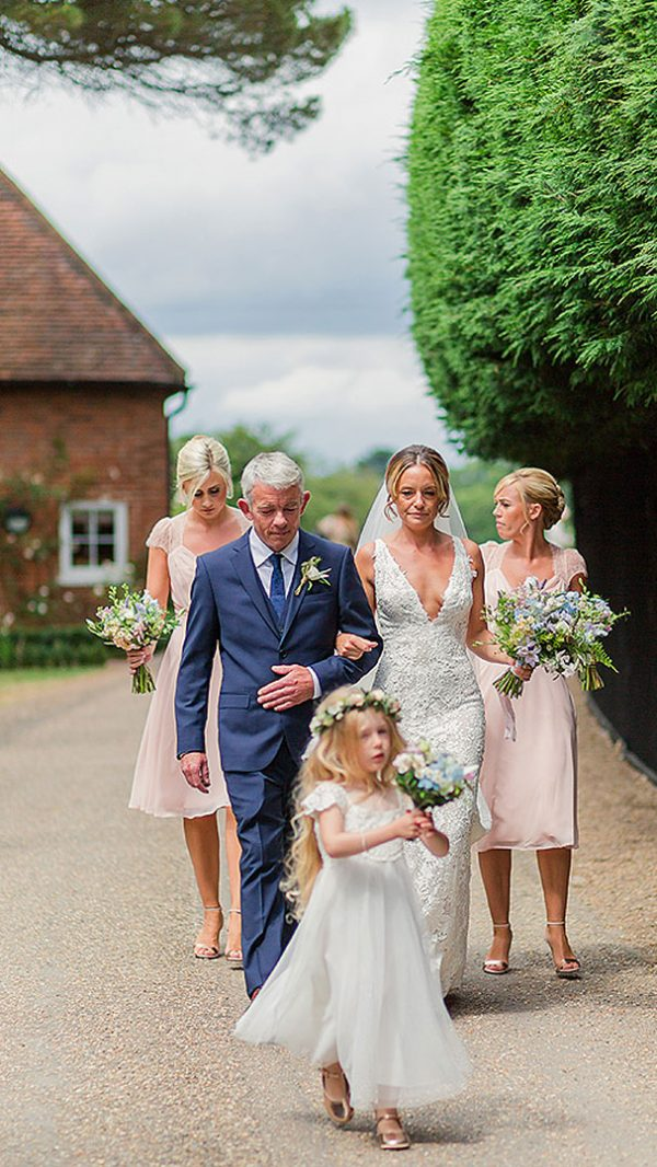 A bride and her bridesmaids leave the Apple Loft Cottage - wedding venues in Essex with accommodation