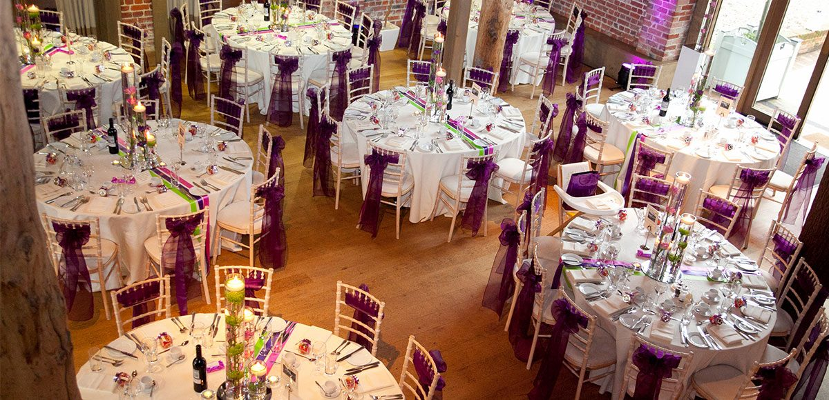 Mill Barn at Gaynes Park dressed in purple decorations – wedding barns Essex