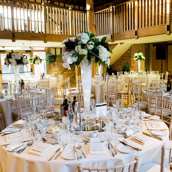 White flowers in a tall vase for wedding decoration – wedding venues in Essex