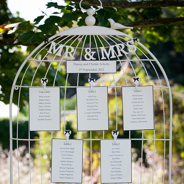 An ivory and black birdcage wedding table plan