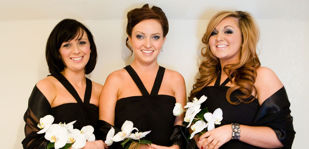 Bridesmaids in black dresses ready for a Winter wedding