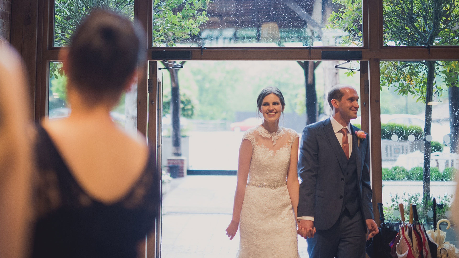 A happy couple arrive into the Mill Barn after saying their marriage vows in a wedding ceremony at Gaynes Park