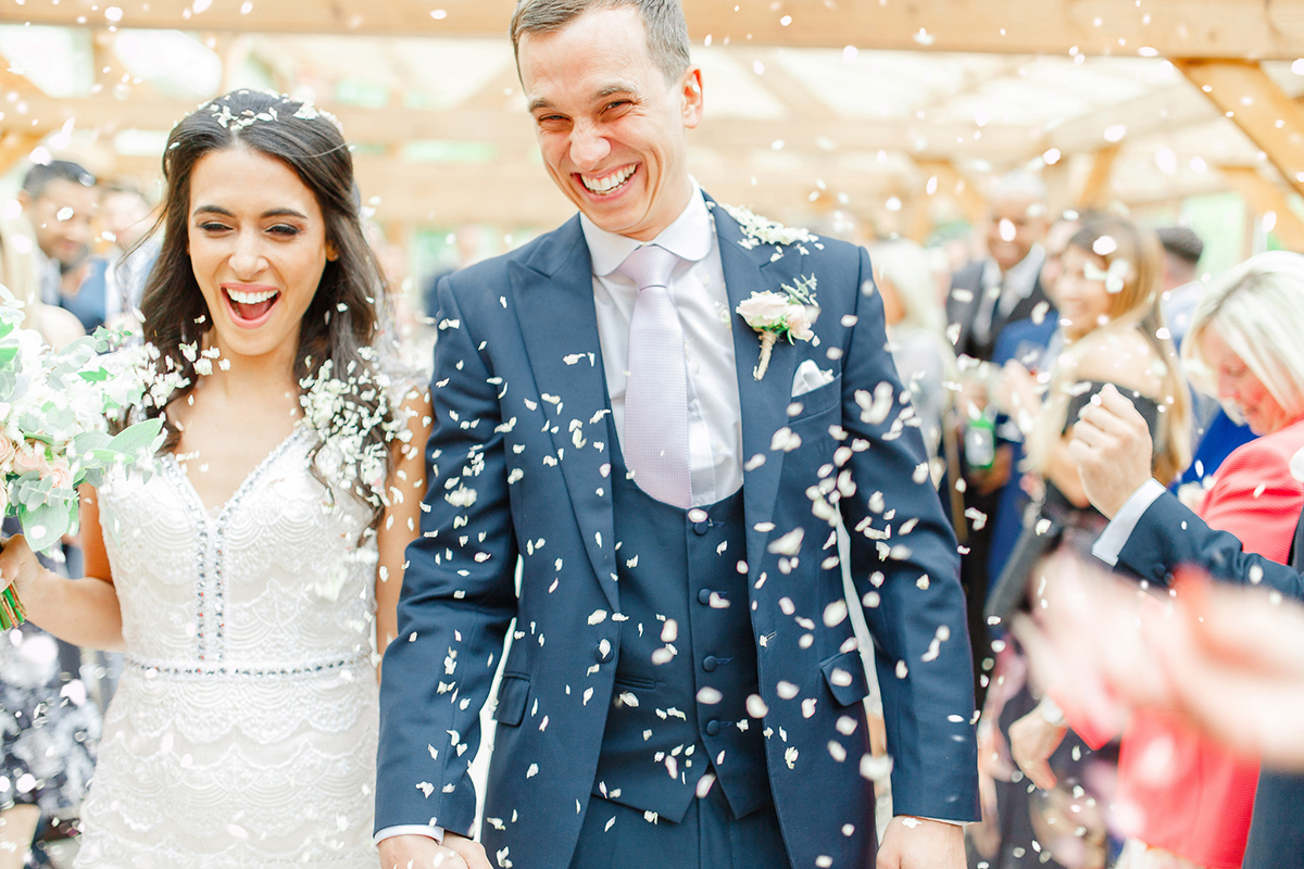 A bride and groom tie the knot in a romantic setting at one of the finest wedding venues in Essex