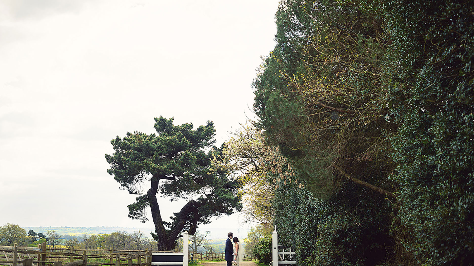 A happy couple share a moment alone at this beautiful countryside wedding venue - wedding barns Essex