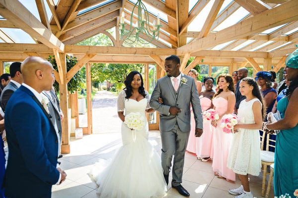 A happy bride arrives at her wedding ceremony to say her marriage vows