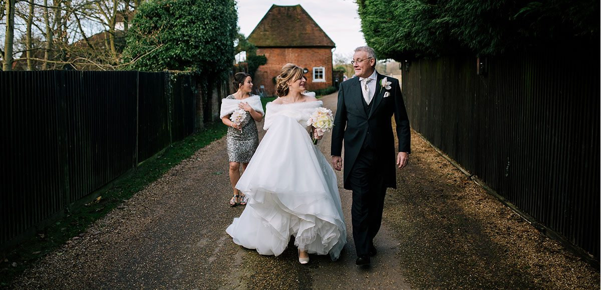 Bride walking with her father at Gaynes Park.